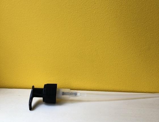 Pompe pour flacon en verre transparent