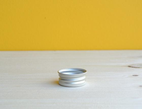 Bouchon aluminium pour flacon en verre